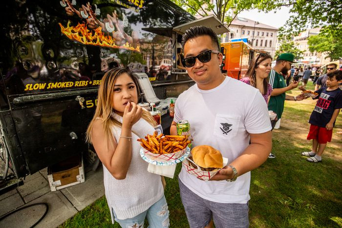 Couple eating burger and fries.jpg