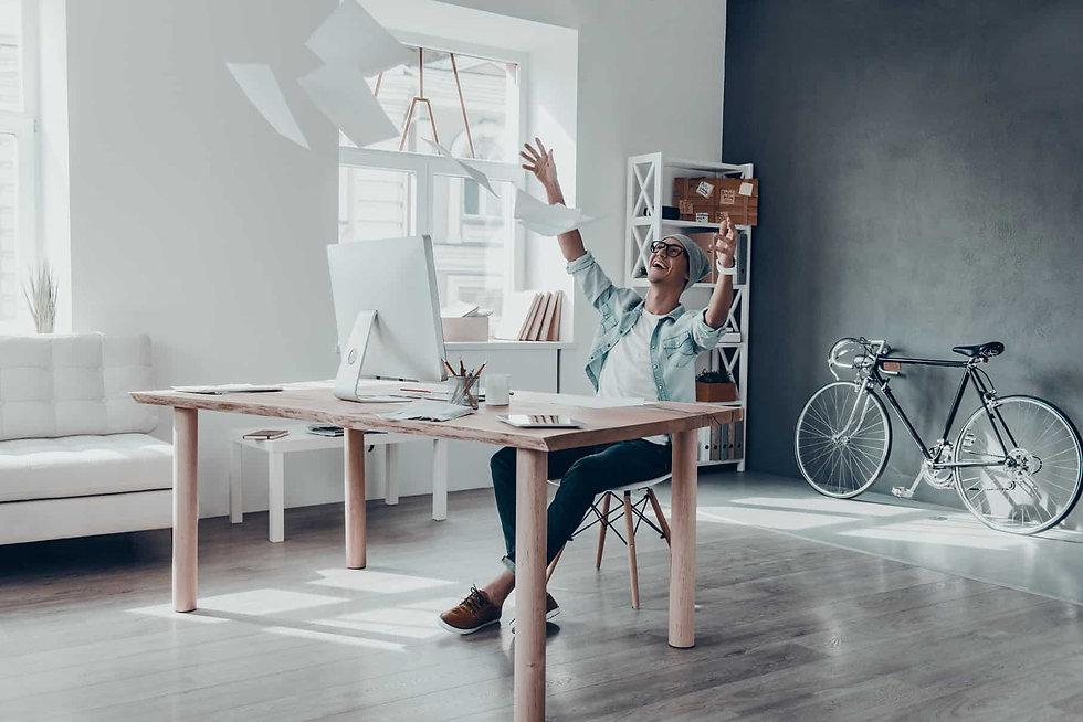 Man-Desk-Excited-Paperwork-in-Air.jpg