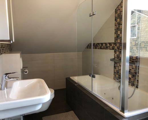 Ferienhaus Küstille Badezimmer mit Whirlpool
