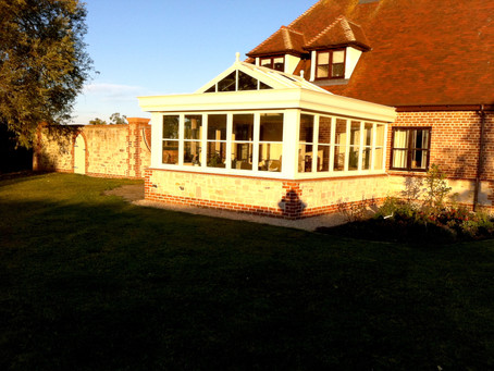 Wooden Framed Orangery Extension with Gable Pitched Glass Roof