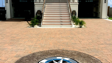 A Custom Medallion Stamp Design on this Beach House Driveway