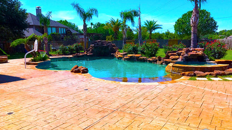 A Backyard Poolside Paradise with a Slate Pattern Fresh Stamped Concrete Overlay