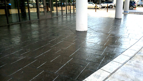 A Car Dealership with a Stamped Concrete Overlay