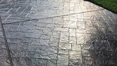 A Stamped Concrete Overlay in a Random Slate Pattern over this Driveway