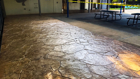 A Community Pool Facility with an Arizona Flagstone Pattern Stamped Concrete Overlay
