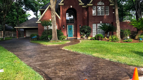 A Residential Driveway with a Random Slate Pattern Stamped Concrete Overlay