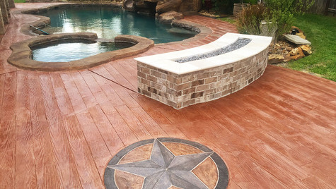 A Backyard Poolside Paradise with A Wood Plank Stamped Concrete Overlay and a Custom Medallion Stamp Design
