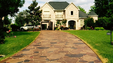 A Driveway Entrance with an Arizona Flagstone Pattern Stamped Concrete Overlay