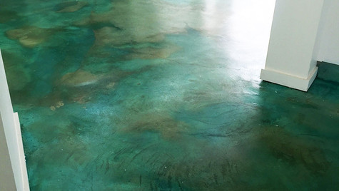 This Stained Concrete creates a bold statement along the floor of this Mixed Blue and Green Color Scheme