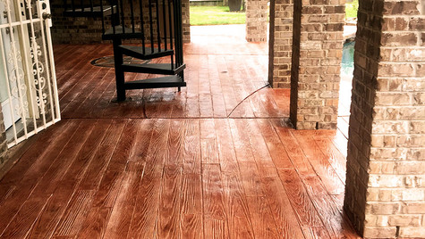 A Patio in a Wood Plank Pattern Stamped Concrete Overlay