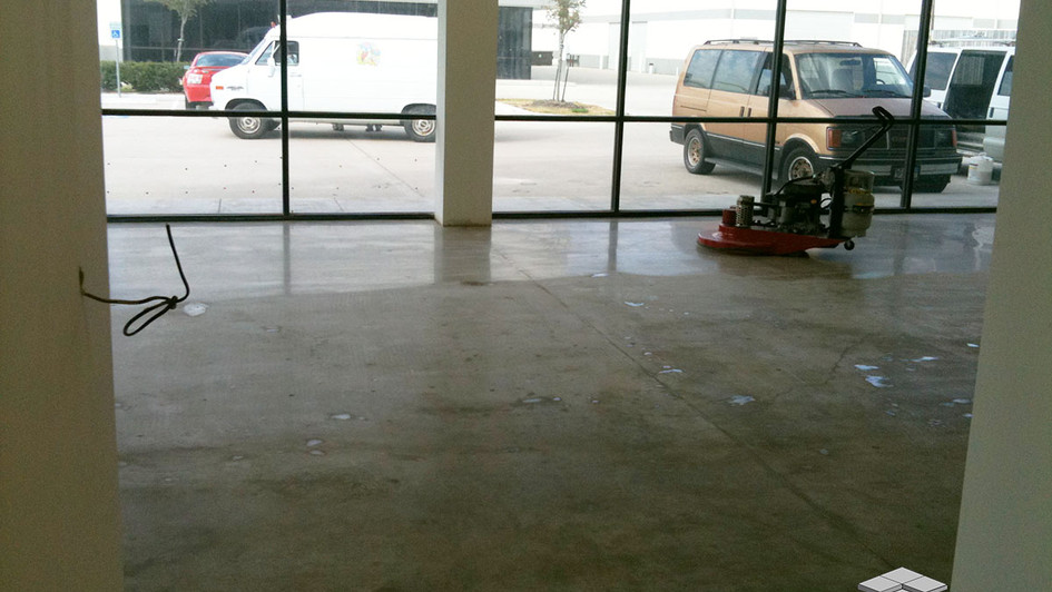 Polished Concrete being installed in this Indoor Commerical Building Space