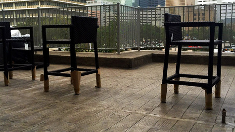 A Highrise Patio in Downtown, Houston with a Wood Plank Pattern Stamped Concrete Overlay
