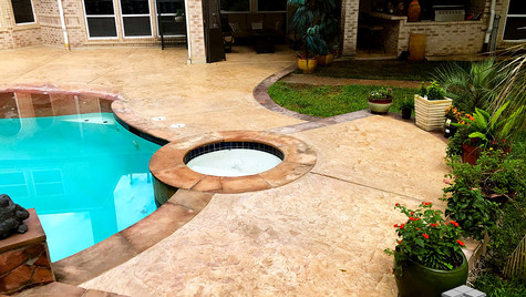 A Stamped Concrete Overlay in a Seamless Slate Texture over Outdoor Poolside Area