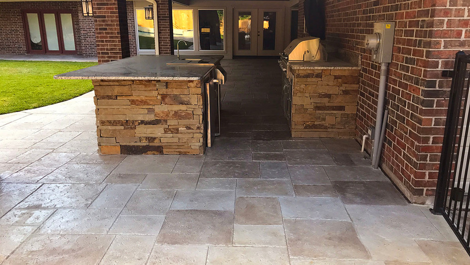 A Stamped Concrete Overlay with a Random Travertine Pattern on this Outdoor Living Area