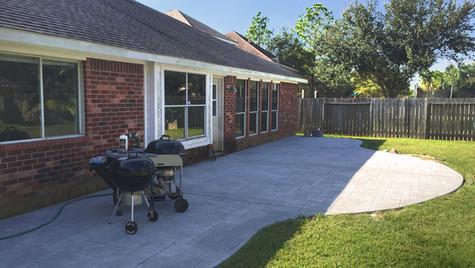 A Unique Curve Design Concrete Patio Perfect for Backyard BBQ