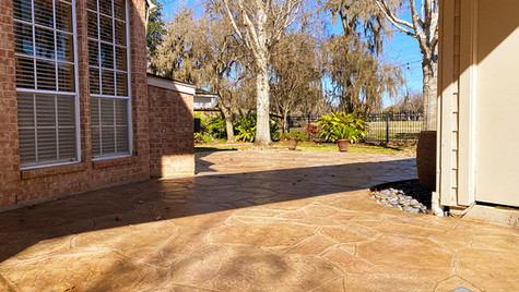 A Driveway in an Arizona Flagstone Stamped Concrete Overlay that extends into the Backyard Patio