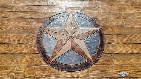 A Custom Medallion Star Stamp Design on a Wood Plank Pattern Concrete