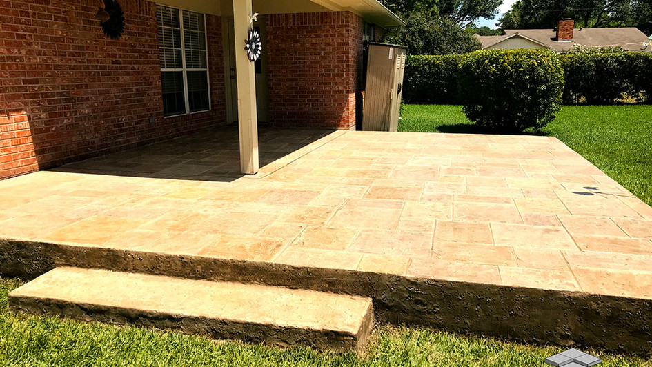 A Stamped Concrete Overlay in a Belgian Slate Pattern over this Backyard Porch Patio