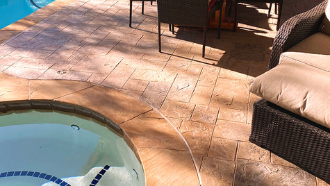 A Beautiful Backyard Retreat with a Stamped Concrete Overlay