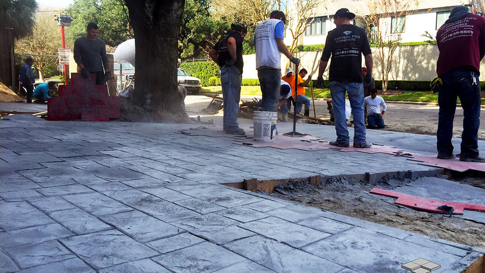 A Fresh Stamped Concrete in a Slate Pattern being installed over this Residential Driveway