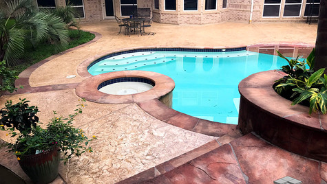 A Backyard Poolside Space with a Seamless Slate Texture Stamped Concrete Overlay