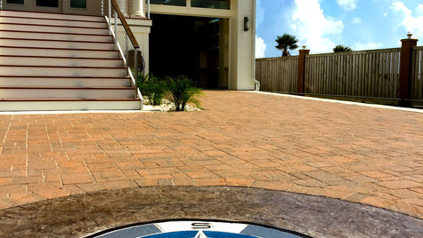 A Beach House Driveway with a Custom Medallion Stamp Design