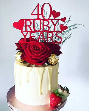 Anniversary cake topper with hearts