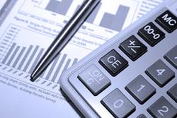 bigstock-Calculator-Steel-Pen-And-Fina-4547387