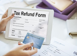 bigstock-Tablet-Tax-Refund-Form-Concept-161407100