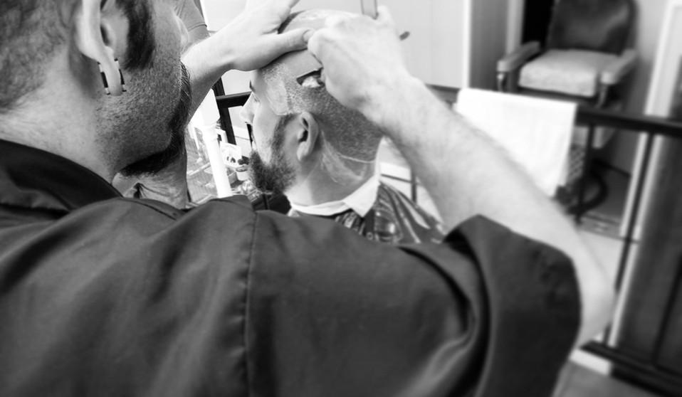 cutting hair black white.jpg