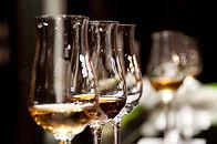 Wine Tasting Events tasting from several wine glasses