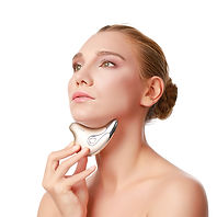 A beautiful women is using our face lift device to tighten the loose skin around her neckj