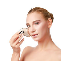a beautiful woman is using our face lift device to get a more voluminous and lifted cheek.