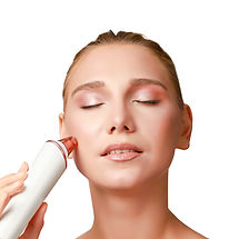 A beautiful woman is using our microdermabrasion tool to exfoliate