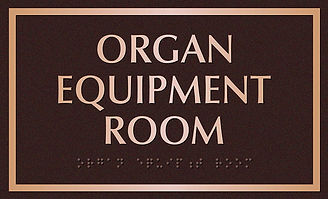 ADA approved bronze room plaque wih braille