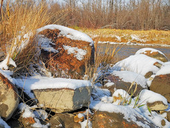 Flowing River with Snowy Rocks