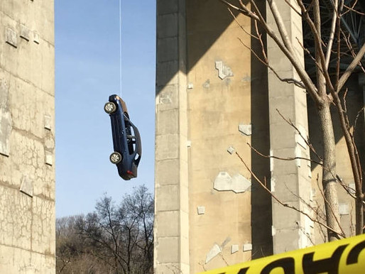 Car Found Dangling From Bridge in Toronto.