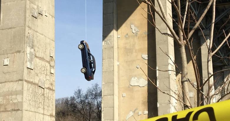 Car Found Dangling From Bridge in Toronto.