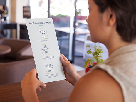 young-girl-holding-a-menu-while-at-a-res