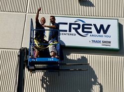 new CREW sign installing 3