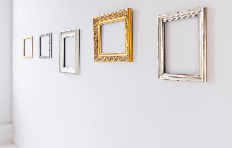 A group of empty frames on the wall