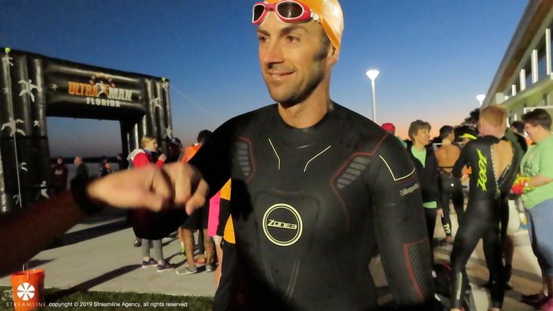 Chris McDonald preparing for his swim in the Zone3 Vanquish wetsuit.