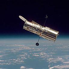 Hubble Space Telescope Against Earth's Horizon