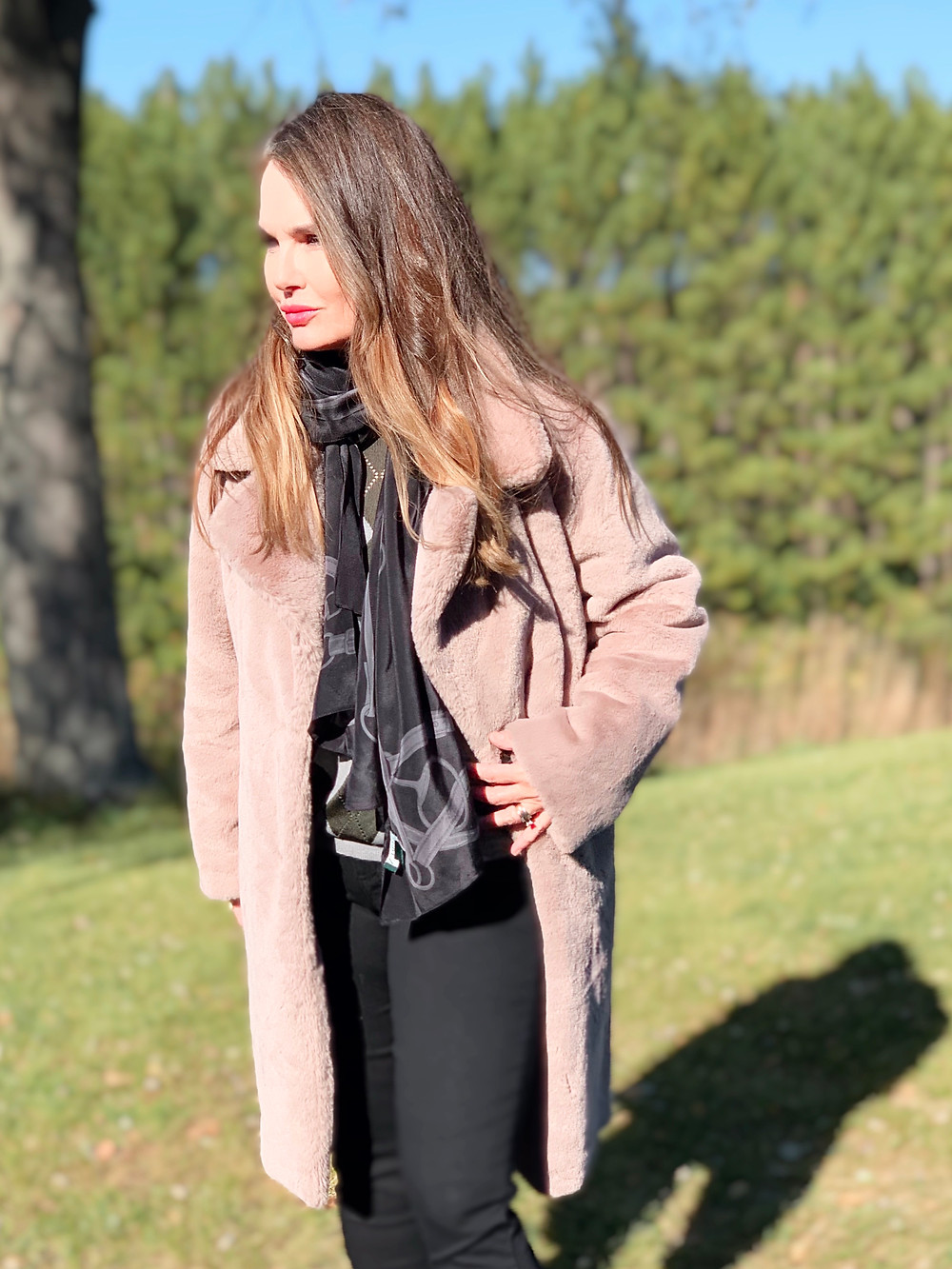 The Backyard Model in a faux fur coat from Amazon.
