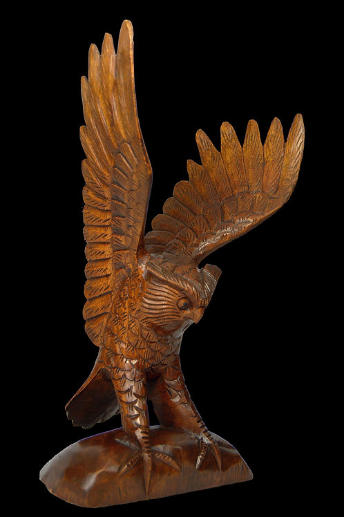 A Finely Carved Owl Sculpture