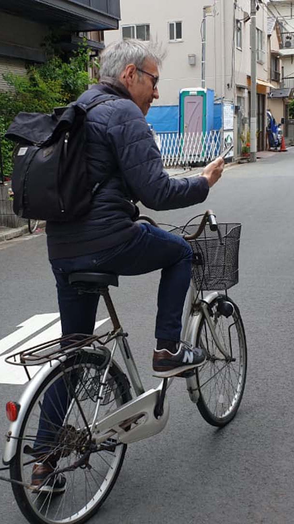 Didier on a cycle.jpg