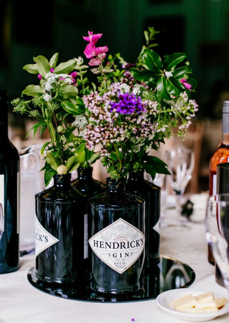 Hendricks Gin centrepieces for a wedding with wildflowers