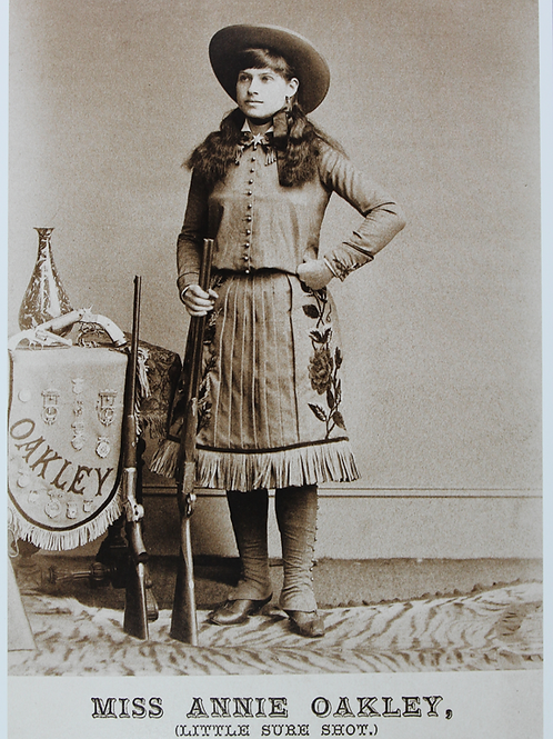 Annie Oakley in shooting outfit