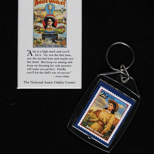Annie Oakley stamp keychain and Annie Oakley poster with motto magnet