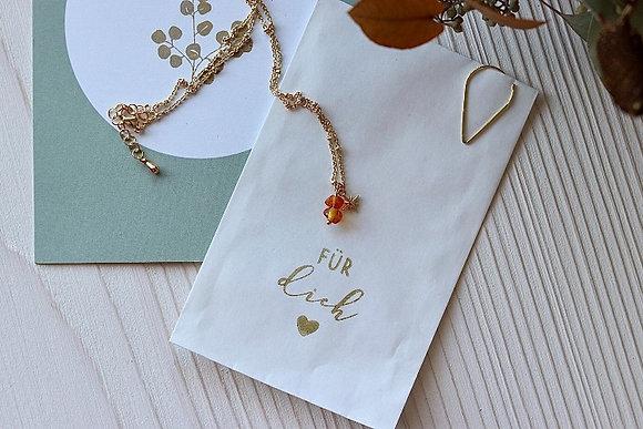 Kette Amber auf Geschenkverpackung